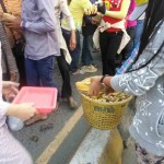 People sharing banna to protestors during CNRP demonstration.