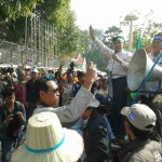Mr. Vorn Pao, IDEA President, speaks infront of Ministry of Economy and Finance demanding low gasoline and rice price.